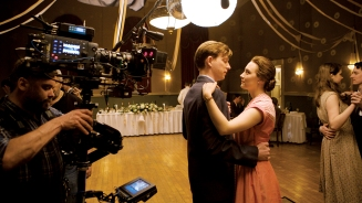 Domhnall Gleeson and Saoirse Ronan on the set of BROOKLYN. Photo by Kerry Brown. © 2015 Twentieth Century Fox Film Corporation All Rights Reserved